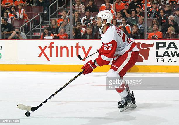 Kyle Quincey of the Detroit Red Wings skates the puck against the Philadelphia Flyers on October 25 2014 at the Wells Fargo Center in Philadelphia...