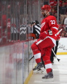 Kyle Quincey of the Detroit Red Wings skates to the penalty box during an NHL game against the Carolina Hurricanes on April 11 2014 at Joe Louis...