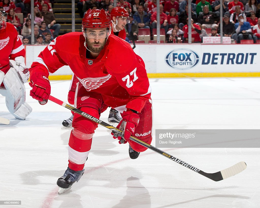 Kyle Quincey of the Detroit Red Wings skates to the play during a NHL game against the Tampa Bay Lightning on March 28 2015 at Joe Louis Arena in...