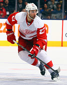 Kyle Quincey of the Detroit Red Wings skates up the ice during NHL action against the Toronto Maple Leafs at the Air Canada Centre December 21 2013...