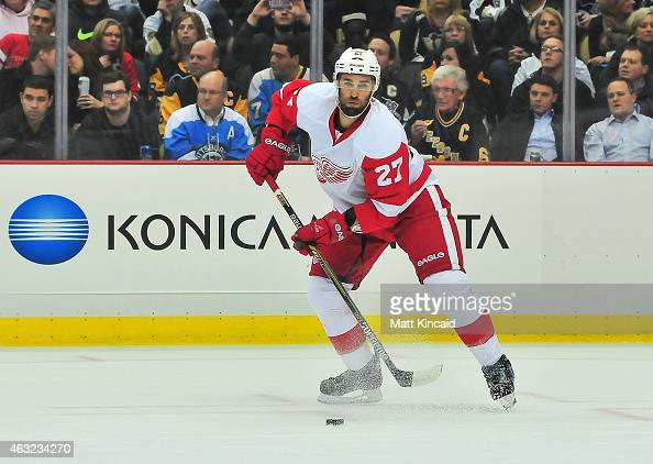 Kyle Quincey of the Detroit Red Wings skates with the puck during a game against the Pittsburgh Penguins at Consol Energy Center on February 11 2015...