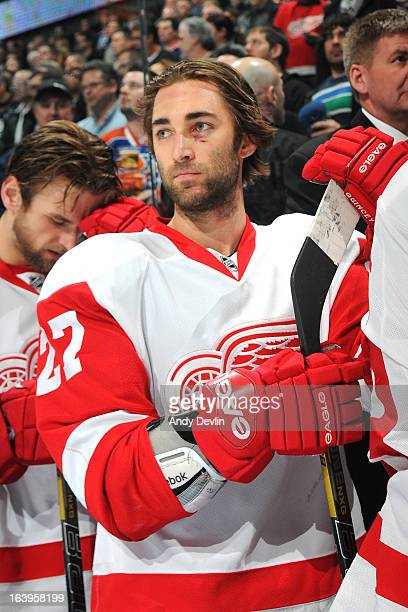 Kyle Quincey of the Detroit Red Wings stands for the singing of the national anthem prior to a game against the Edmonton Oilers on March 15 2013 at...