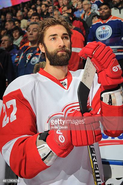 Kyle Quincey of the Detroit Red Wings stands for the singing of the national anthem prior to the game against the Edmonton Oilers on January 6 2015...