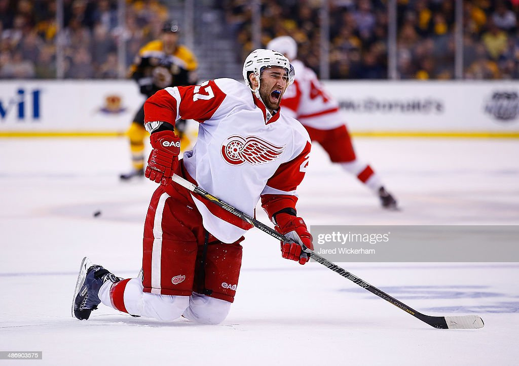 <a gi-track='captionPersonalityLinkClicked' href=/galleries/search?phrase=Kyle+Quincey&family=editorial&specificpeople=2234340 ng-click='$event.stopPropagation()'>Kyle Quincey</a> #27 of the Detroit Red Wings winces in pain following a hit in the third period against the Boston Bruins in Game Five of the First Round of the 2014 NHL Stanley Cup Playoffs at TD Garden on April 26, 2014 in Boston, Massachusetts.