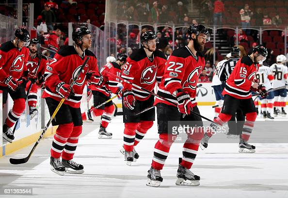 Kyle Quincey of the New Jersey Devils and the rest of the team head to the locker room after the loss to the Florida Panthers on January 9 2017 at...