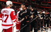 Kyle Quincey the Detroit Red Wings and Ryan Getzlaf of the Anaheim Ducks participate in the post game player handshake after the Red Wings 32 victory...
