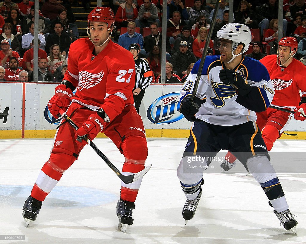 Kyle Quincy #27 of the Detroit Red Wings and <a gi-track='captionPersonalityLinkClicked' href=/galleries/search?phrase=Andy+McDonald+-+Ice+Hockey+Player&family=editorial&specificpeople=206576 ng-click='$event.stopPropagation()'>Andy McDonald</a> #10 of the St Louis Blues battle for position during a NHL game at Joe Louis Arena on February 1, 2013 in Detroit, Michigan.