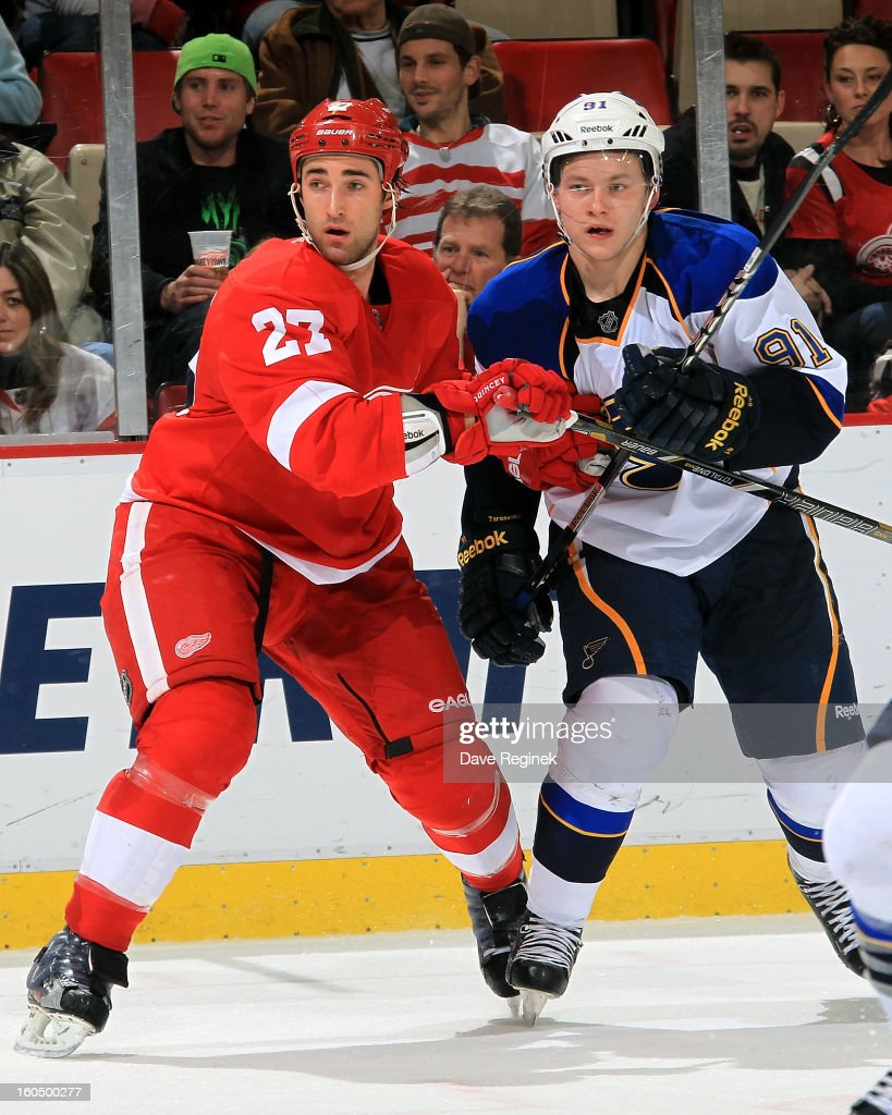 Kyle Quincy #27 of the Detroit Red Wings and <a gi-track='captionPersonalityLinkClicked' href=/galleries/search?phrase=Vladimir+Tarasenko&family=editorial&specificpeople=6142635 ng-click='$event.stopPropagation()'>Vladimir Tarasenko</a> #91 of the St Louis Blues battle for position during a NHL game at Joe Louis Arena on February 1, 2013 in Detroit, Michigan.