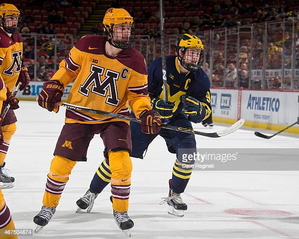 Kyle Rau of the Minnesota Golden Gophers and Andrew Copp of the Michigan Wolverines follows the play during the finals of Big Ten Mens Ice Hockey...