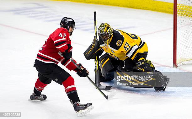 Kyle Rau of the Portland Pirates scores during the first round of a shootout against the Providence Bruins during an American Hockey League game at...