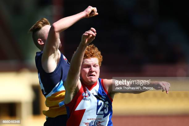 Kyle Reid of the Power and Keeling Betson of the Pioneers compete for the ball during the round three TAC Cup match between XXXX and XXXX at Queen...