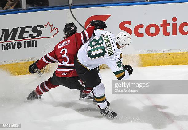 Kyle Rhodes of the Guelph Storm skates against Alex Formenton of the London Knights during an OHL game at Budweiser Gardens on December 16 2016 in...