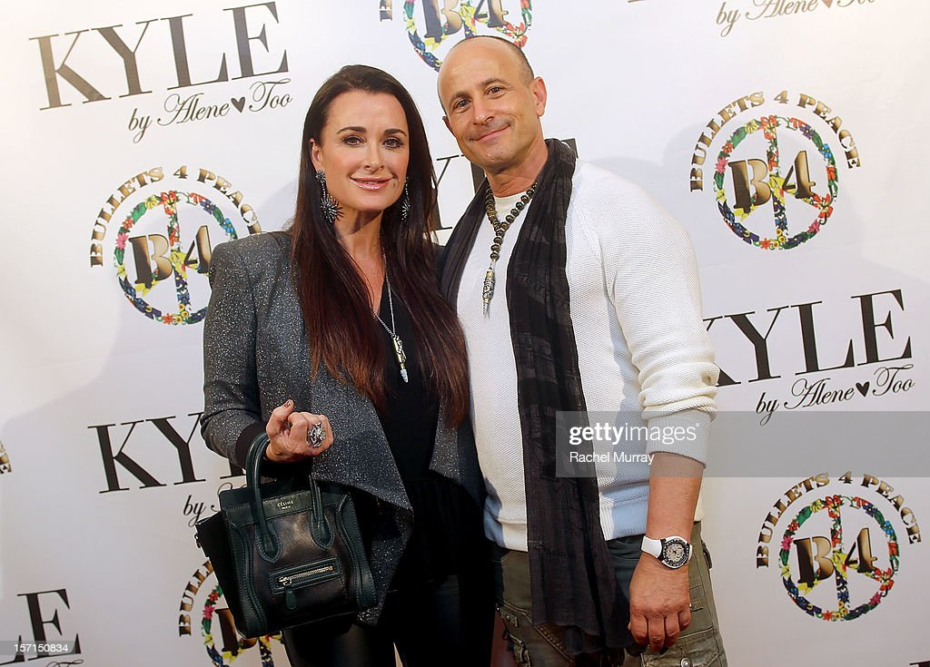 <a gi-track='captionPersonalityLinkClicked' href=/galleries/search?phrase=Kyle+Richards&family=editorial&specificpeople=2586434 ng-click='$event.stopPropagation()'>Kyle Richards</a> (L) and Bullets 4 Peace designer and creator Rafi Anteby attends Kyle By Alene Too holiday shopping event featuring Bullets For Peace benefiting Safe Passage Charity on November 28, 2012 in Beverly Hills, California.