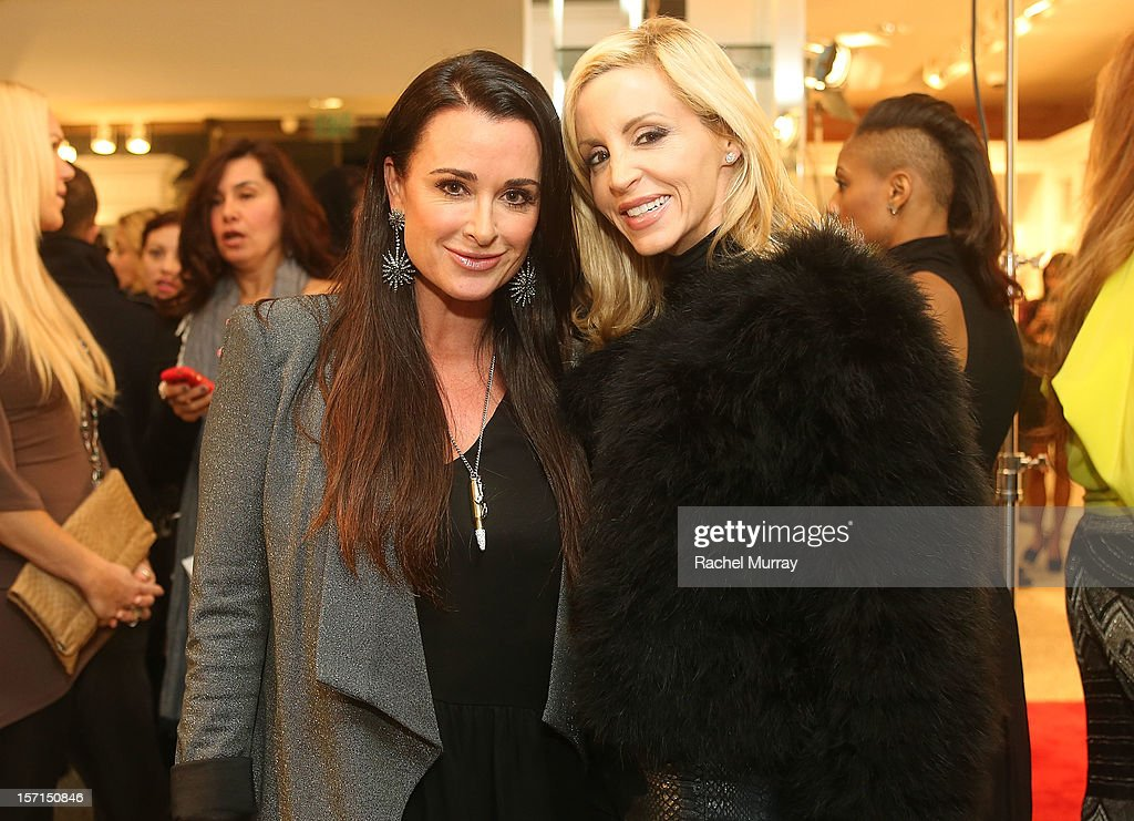 Kyle Richards and Camille Grammer attend Kyle By Alene Too holiday shopping event featuring Bullets For Peace benefiting Safe Passage Charity on November 28, 2012 in Beverly Hills, California.