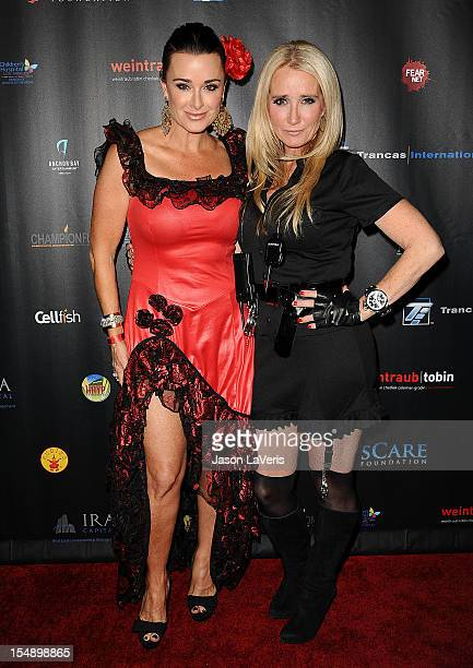 Kyle Richards and Kim Richards attend the sCare Foundation's 2nd annual Halloween benefit event at The Conga Room at LA Live on October 28 2012 in...