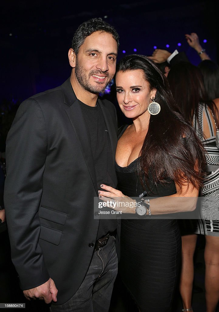 Kyle Richards (R) and Mauricio Umansky attend The Red Hot Chili Peppers performance on New Year's Eve at The Cosmopolitan of Las Vegas on December 31, 2012 in Las Vegas, Nevada.