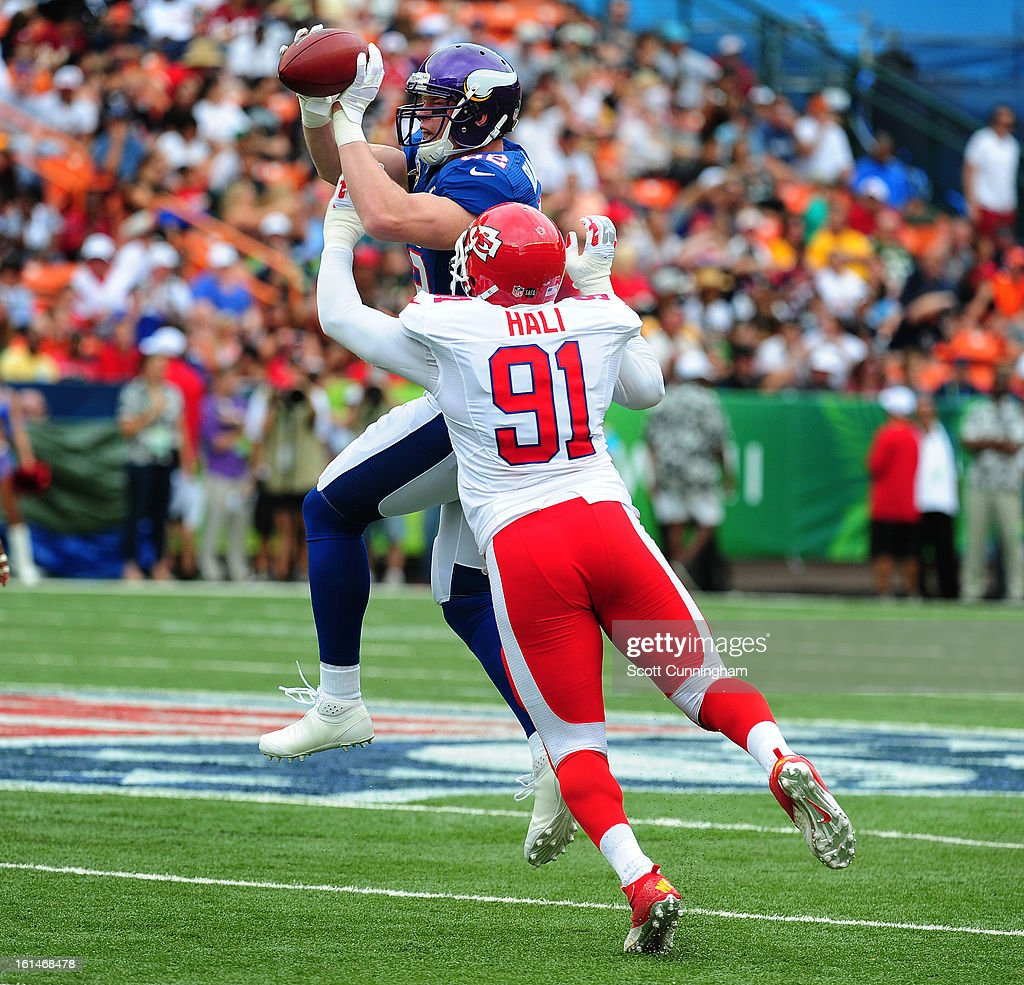 Kyle Rudolph #82 of the Minnesota Vikings and the NFC makes a catch against Tamba Hali #91 of the AFC team during the 2013 Pro Bowl at Aloha Stadium on January 27, 2013 in Honolulu, Hawaii.