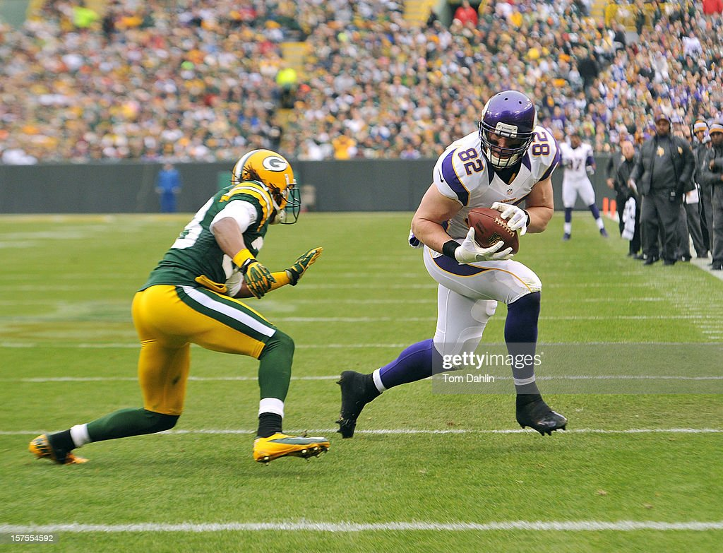 Kyle Rudolph #82 of the Minnesota Vikings carries the ball during an NFL game against the Green Bay Packers at Lambeau Field on December 2, 2012 in Green Bay, Wisconsin.