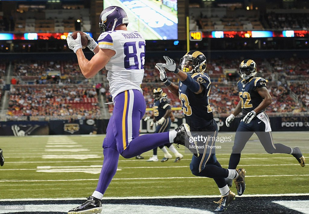 Kyle Rudolph #82 of the Minnesota Vikings catches a fourth quarter touchdown against the St. Louis Rams at the Edward Jones Dome on September 7, 2014 in St. Louis, Missouri. The Vikings defeated the Rams 34-6.