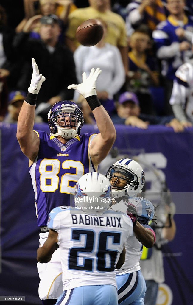 <a gi-track='captionPersonalityLinkClicked' href=/galleries/search?phrase=Kyle+Rudolph&family=editorial&specificpeople=5537859 ng-click='$event.stopPropagation()'>Kyle Rudolph</a> #82 of the Minnesota Vikings makes a catch for a touchdown over Jordan Babineaux #26 and Michael Griffin #33 of the Tennessee Titans during the third quarter of the game on October 7, 2012 at Mall of America Field at the Hubert H. Humphrey Metrodome in Minneapolis, Minnesota. The Vikings defeated the Titans 30-7.