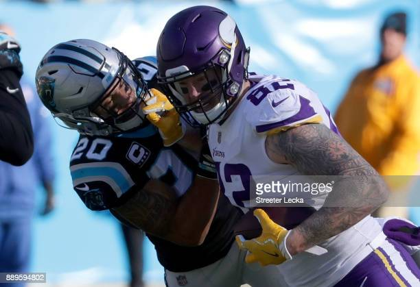 Kyle Rudolph of the Minnesota Vikings runs the ball against Kurt Coleman of the Carolina Panthers in the second quarter during their game at Bank of...