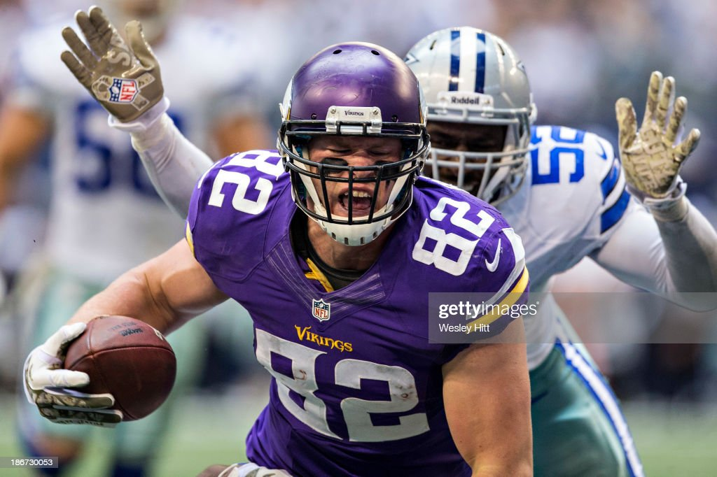 Kyle Rudolph of the Minnesota Vikings scores a touchdown against the Dallas Cowboys at ATT Stadium on November 3 2013 in Arlington Texas The Cowboys...