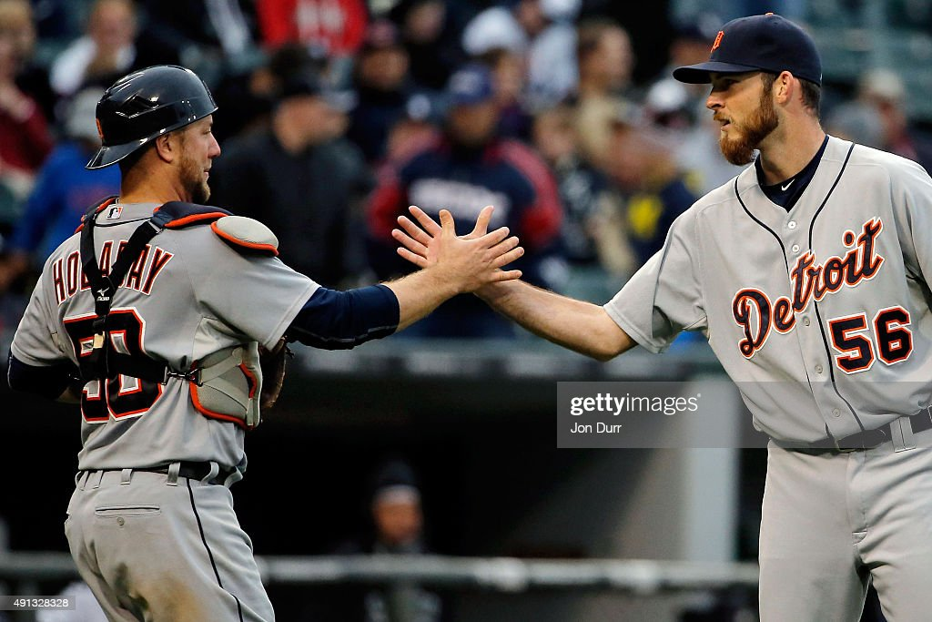 Kyle Ryan #56 of the Detroit Tigers and Bryan Holaday #50 celebrate their win over the Chicago White Sox at U.S. Cellular Field on October 4, 2015 in Chicago, Illinois. The Detroit Tigers won 6-0.