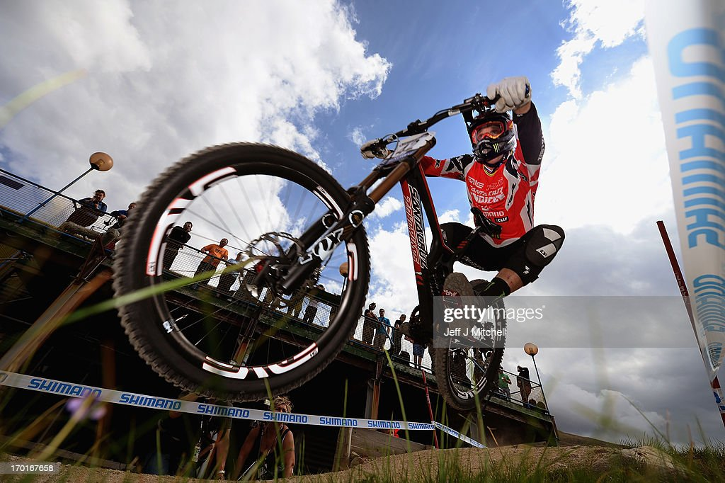 Kyle Sangers of Canada competes in the men's downhill qualifying round at the UCI Mountain Bike World Cup on June 8, 2013 in Fort William,Scotland.