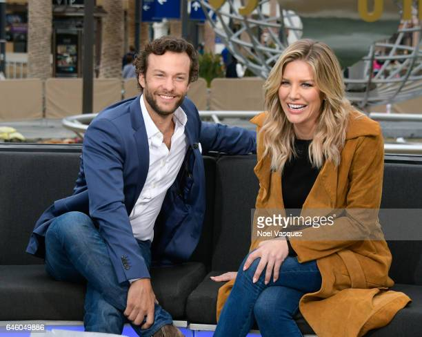 Kyle Schmid and Charissa Thompson visit 'Extra' at Universal Studios Hollywood on February 27 2017 in Universal City California