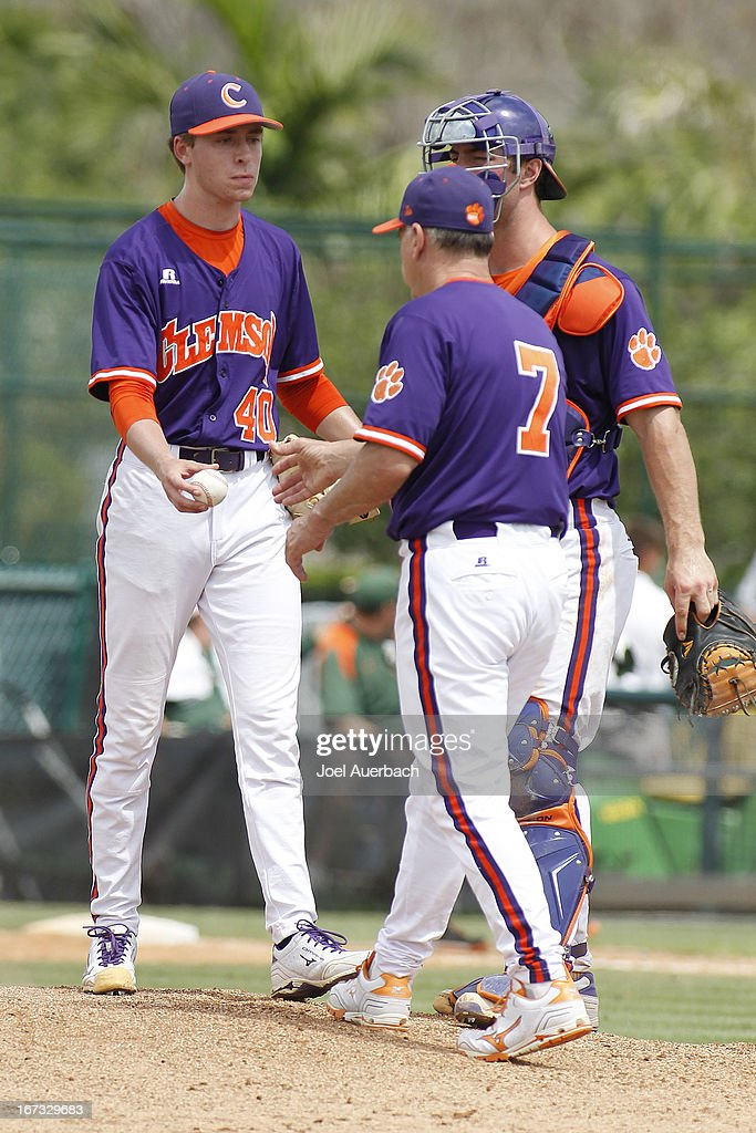 Kyle Schnell #40 hands the ball to head coach Jack Leggett of the Clemson Tigers as he is removed from the game against the Miami Hurricanes in the eighth inning on April 21, 2013 at Alex Rodriguez Park at Mark Light Field in Coral Gables, Florida. Miami defeated Clemson 7-0.
