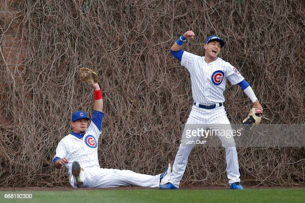Kyle Schwarber of the Chicago Cubs and Albert Almora Jr #5 celebrate after an apparent catch on a hit by Enrique Hernandez of the Los Angeles Dodgers...