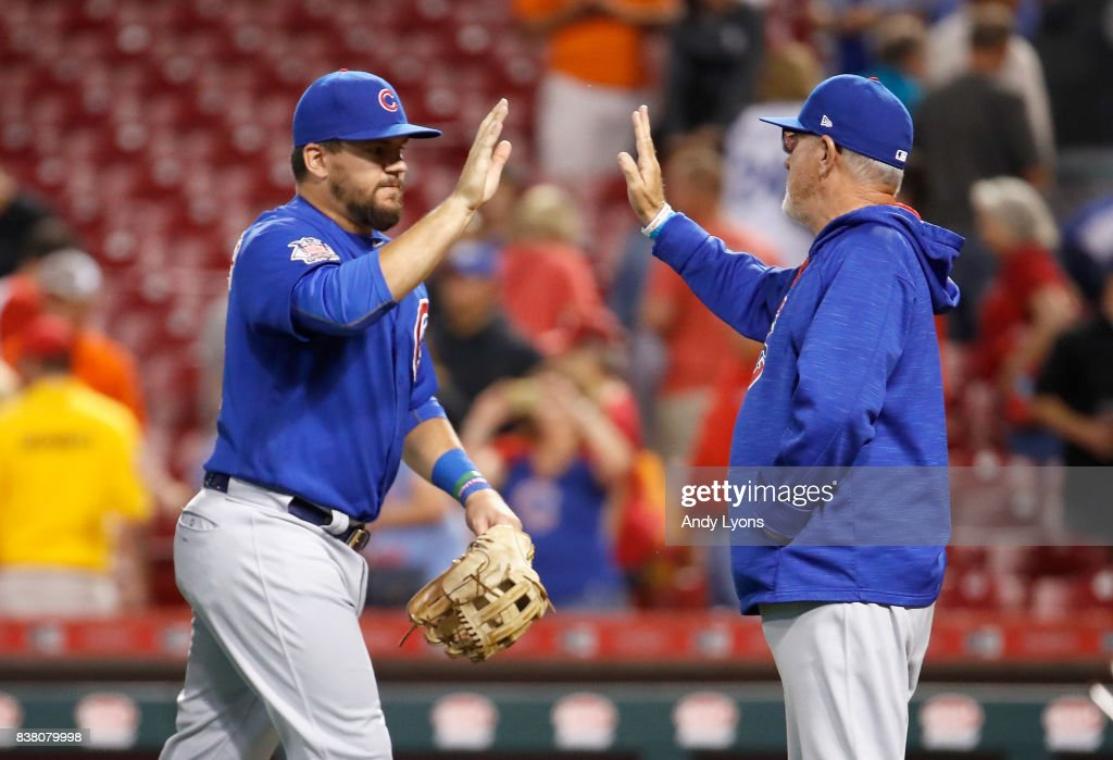 Kyle Schwarber #12 of the Chicago Cubs and Joe Maddon the manager celebrate after the 9-3 win against the Cincinnati Reds at Great American Ball Park on August 23, 2017 in Cincinnati, Ohio.