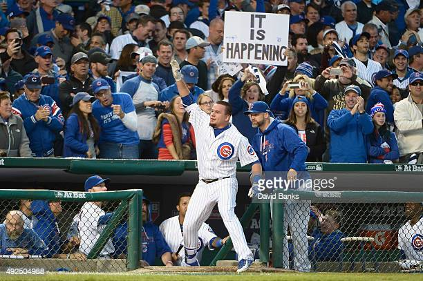 Kyle Schwarber of the Chicago Cubs celebrates at the dugout after hitting a solo home run in the seventh inning against the St Louis Cardinals during...
