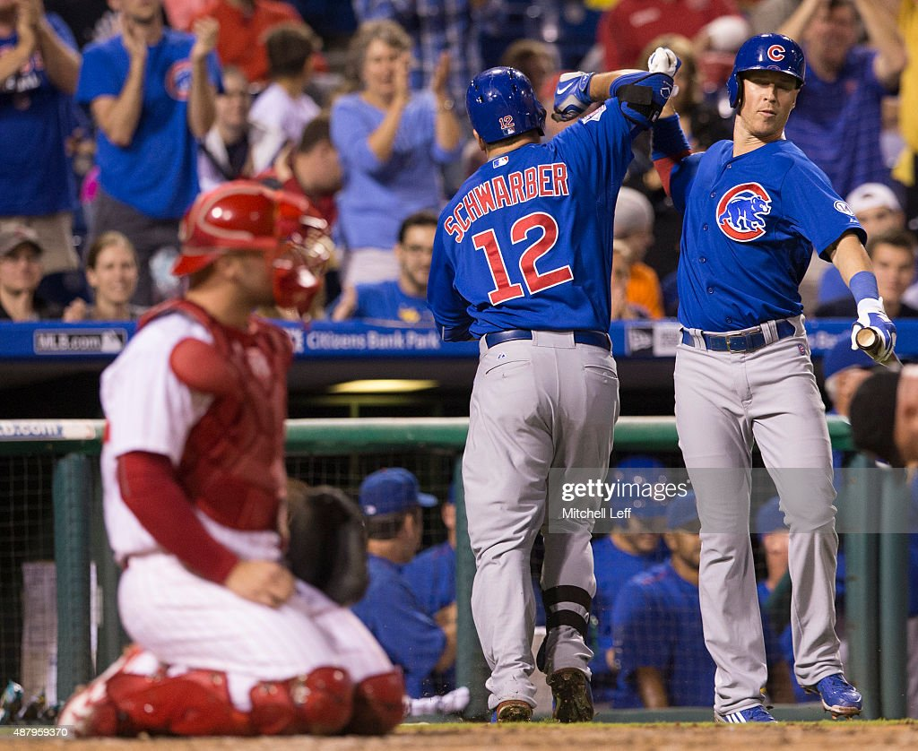 <a gi-track='captionPersonalityLinkClicked' href=/galleries/search?phrase=Kyle+Schwarber&family=editorial&specificpeople=10982366 ng-click='$event.stopPropagation()'>Kyle Schwarber</a> #12 of the Chicago Cubs celebrates with <a gi-track='captionPersonalityLinkClicked' href=/galleries/search?phrase=Chris+Coghlan&family=editorial&specificpeople=4391543 ng-click='$event.stopPropagation()'>Chris Coghlan</a> #8 after his solo home run in the top of the third inning against the Philadelphia Phillies on September 12, 2015 at Citizens Bank Park in Philadelphia, Pennsylvania.