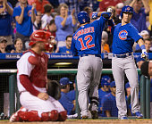 Kyle Schwarber of the Chicago Cubs celebrates with Chris Coghlan after his solo home run in the top of the third inning against the Philadelphia...