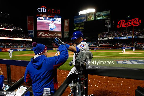 Kyle Schwarber of the Chicago Cubs celebrates with his teammates in the dugout after hitting a solo home run in the eighth inning against Matt Harvey...