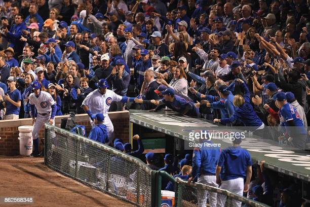 Kyle Schwarber of the Chicago Cubs celebrates with teammates after hitting a home run in the first inning against the Los Angeles Dodgers during game...