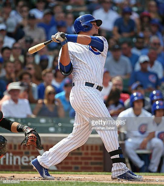 Kyle Schwarber of the Chicago Cubs hits a double in the 1st inning against the San Francisco Giants at Wrigley Field on August 7 2015 in Chicago...