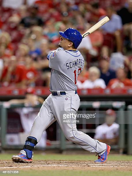 Kyle Schwarber of the Chicago Cubs hits a game tying two run home run in the 9th inning against the Cincinnati Reds in the second inning at Great...