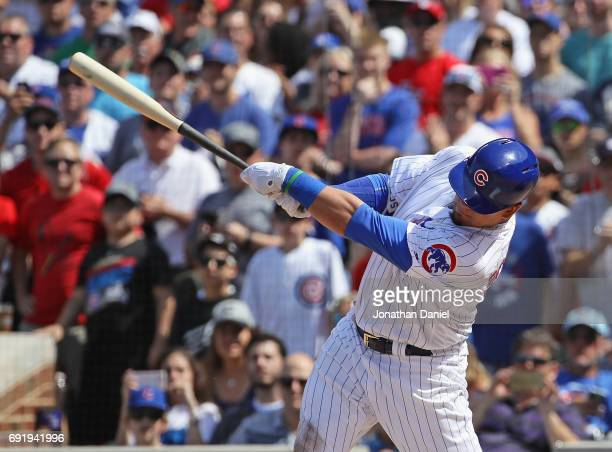 Kyle Schwarber of the Chicago Cubs hits a grand slam home run in the 7th inning against the St Louis Cardinals at Wrigley Field on June 3 2017 in...