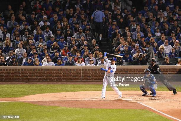 Kyle Schwarber of the Chicago Cubs hits a home run in the first inning against the Los Angeles Dodgers during game three of the National League...
