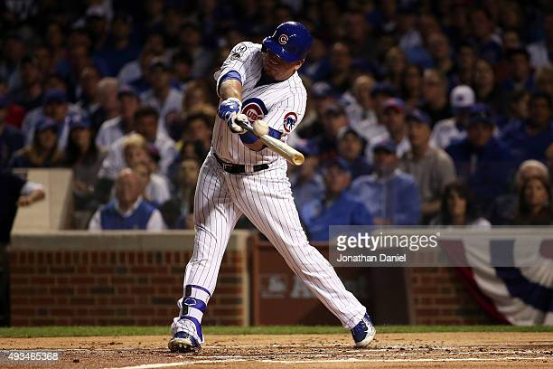 Kyle Schwarber of the Chicago Cubs hits a solo home run in the first inning against Jacob deGrom of the New York Mets during game three of the 2015...