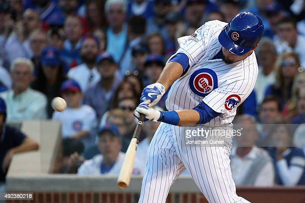 Kyle Schwarber of the Chicago Cubs hits a solo home run in the second inning against the St Louis Cardinals during game three of the National League...