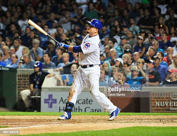 Kyle Schwarber of the Chicago Cubs hits a tworun home run against the Cincinnati Reds during the seventh inning on September 1 2015 at Wrigley Field...