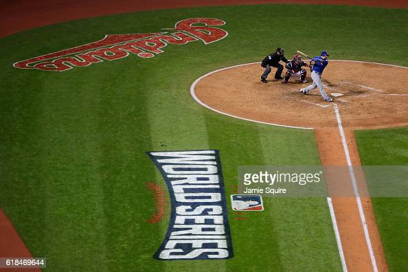 Kyle Schwarber of the Chicago Cubs hits an RBI single to score Anthony Rizzo during the third inning against the Cleveland Indians in Game Two of the...