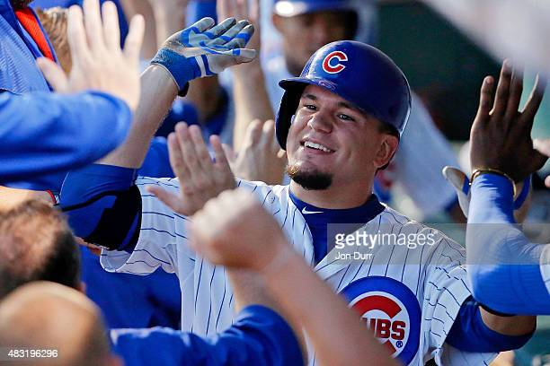 Kyle Schwarber of the Chicago Cubs is congratualted in the dugout after hitting a three run home run against the San Francisco Giants during the...