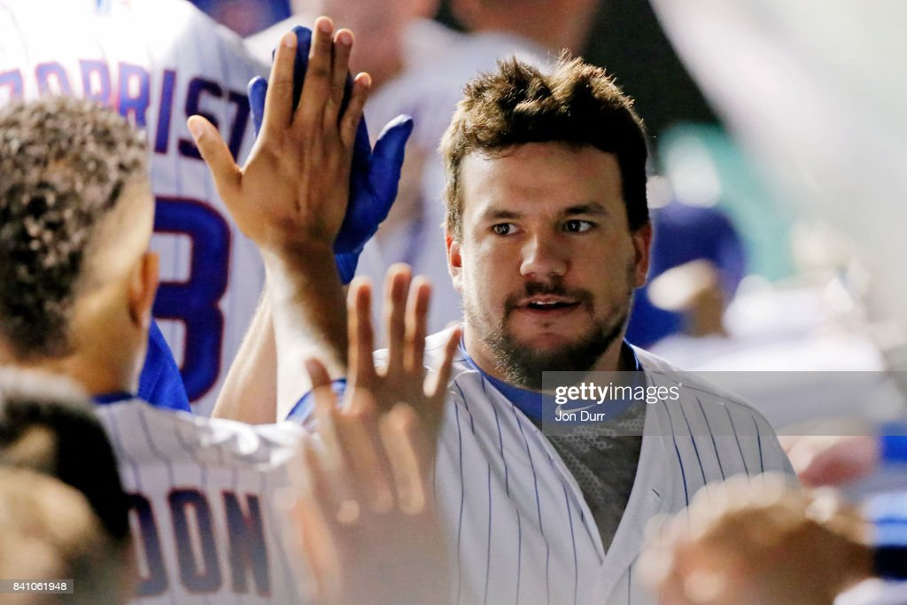 Kyle Schwarber #12 of the Chicago Cubs is congratulated by Hector Rondon #56 (L) after hitting a two-run home run against the Pittsburgh Pirates during the seventh inning at Wrigley Field on August 30, 2017 in Chicago, Illinois.