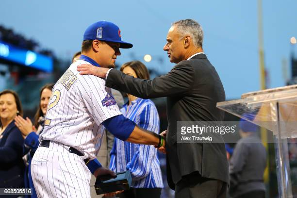 Kyle Schwarber of the Chicago Cubs is greeted by Commissioner of Baseball Robert D Manfred Jr during the World Series ring ceremony ahead of the game...