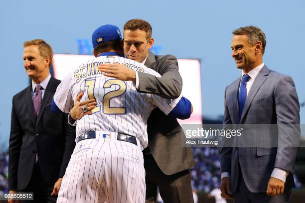 Kyle Schwarber of the Chicago Cubs is greeted by President of Baseball Operations Theo Epstein during the World Series ring ceremony ahead of the...