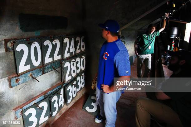 Kyle Schwarber of the Chicago Cubs looks inside the Green Monster before a game against the Boston Red Sox at Fenway Park on April 28 2017 in Boston...